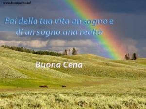 arcobaleno sopra colline verdeggianti